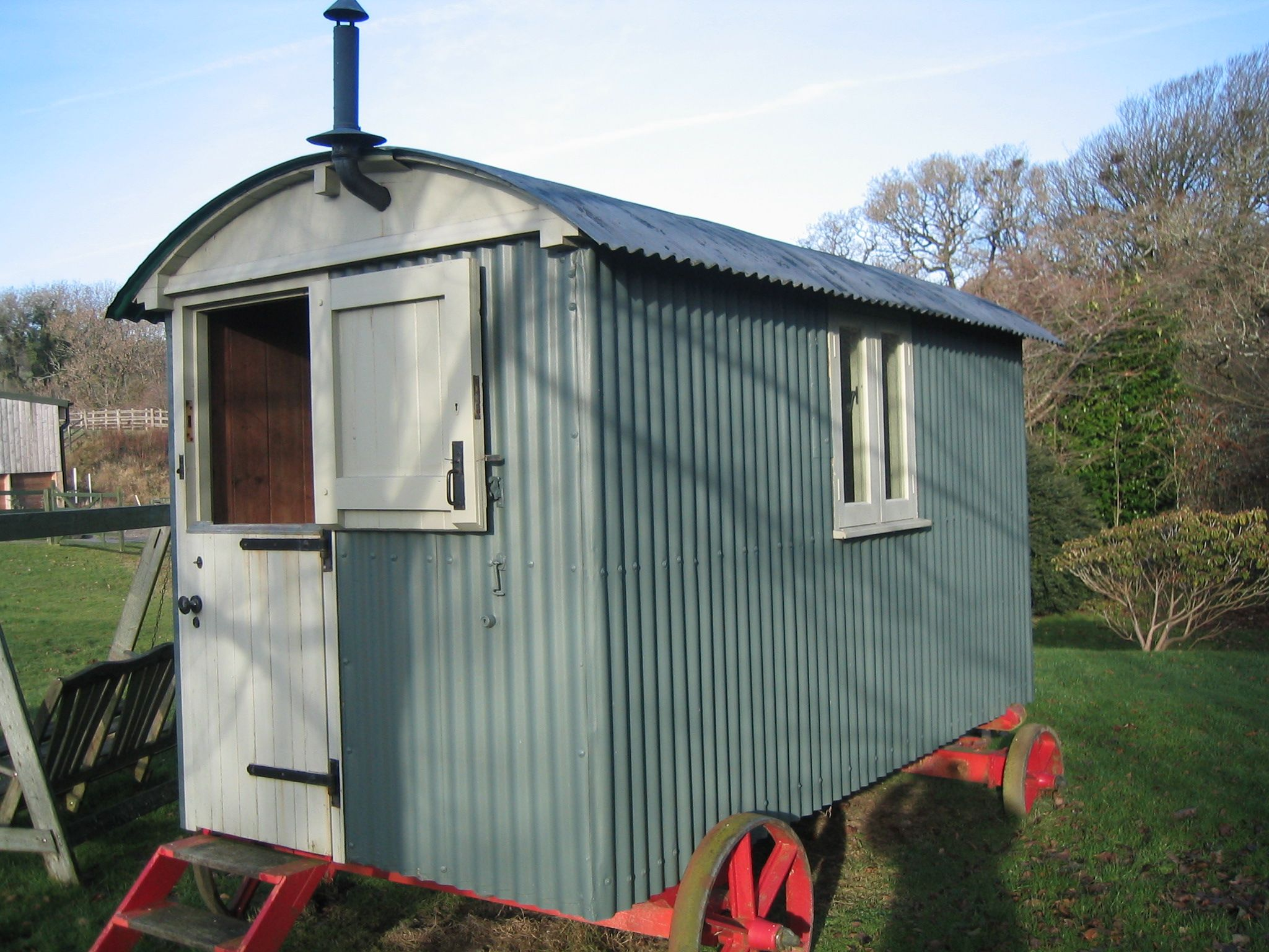 Side view of renovated hut, new doors, all old timber removed and stabilised. Hardwood windows.
