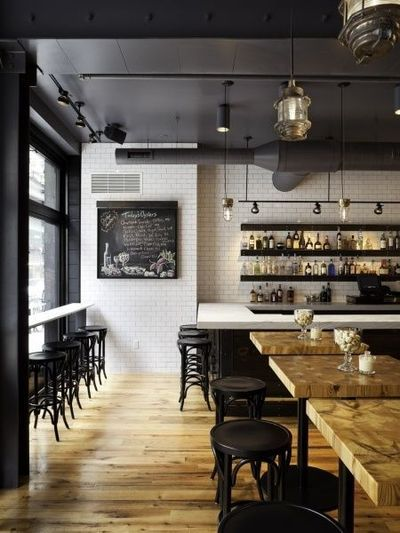 Interior Black Ceiling White Tiles And Wood Restaurant