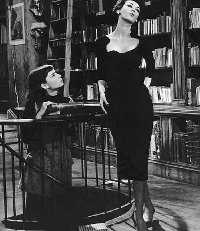 "Dovima and Audrey Hepburn with books in Funny Face, 1957. Richard Avedon, whose innovative photographs of haute couture had inspired Leonard Gershe's story, was hired as ""special visual consultant"" for Funny Face. One of Avedon's favorite models,..."