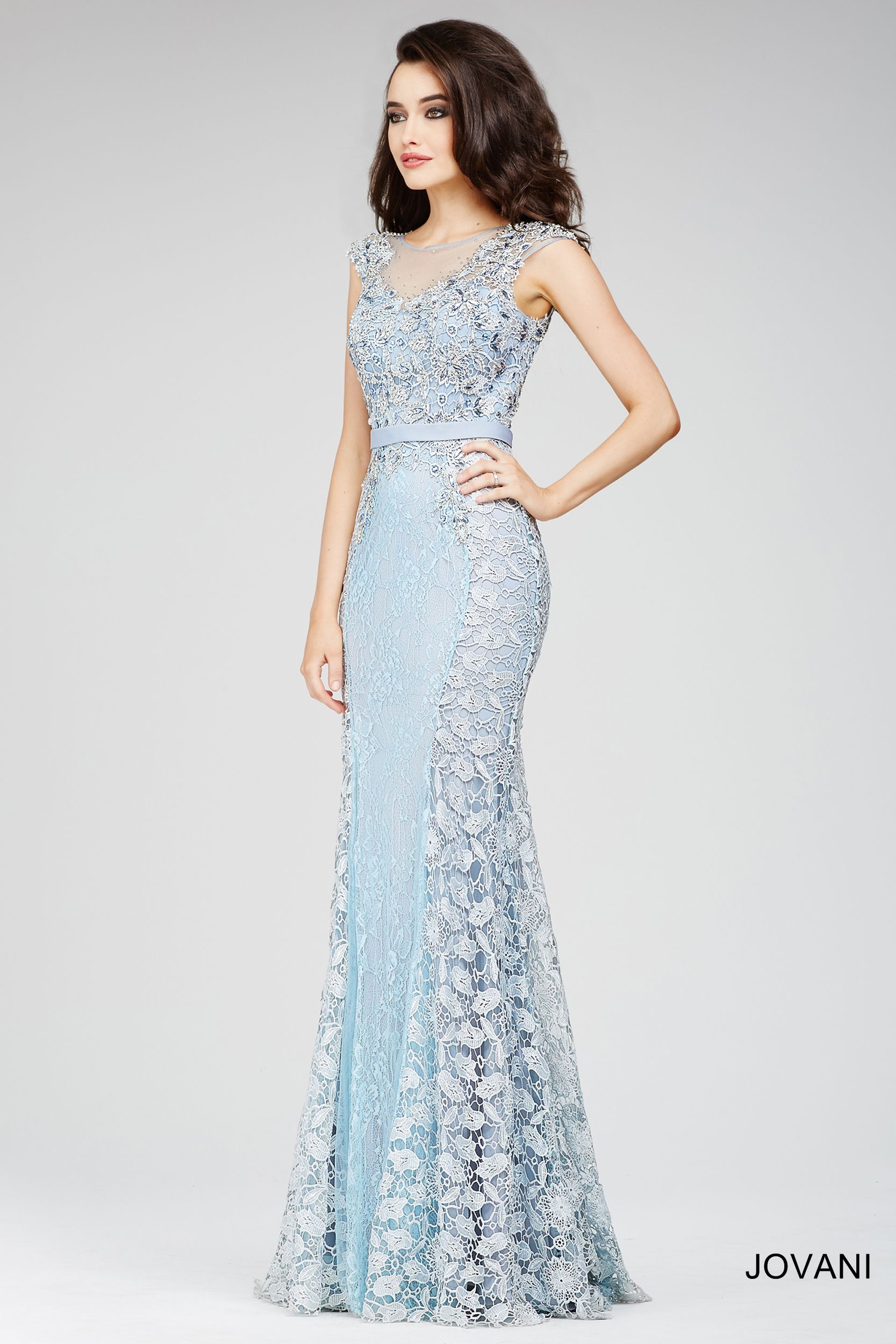Stunning blue illusion sheath dress features cap sleeves and floral