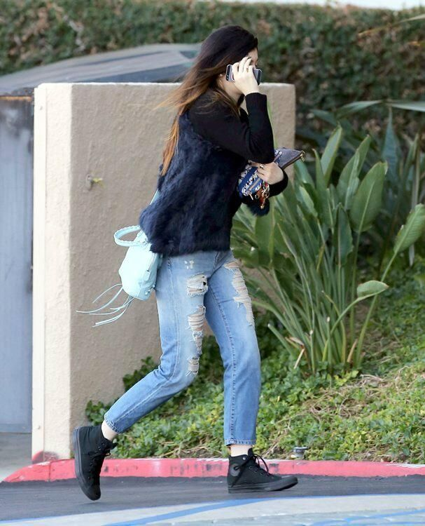 6e54b117968 Kylie Jenner wearing Converse Chuck Taylor All Star sneakers in Black  Monochrome Balenciaga Classic Mini Bowling Bag Topshop Moto Vintage  Boyfriend Jeans ...