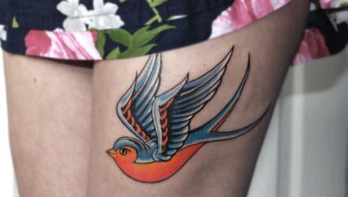 Pretty swallow bird tattoo