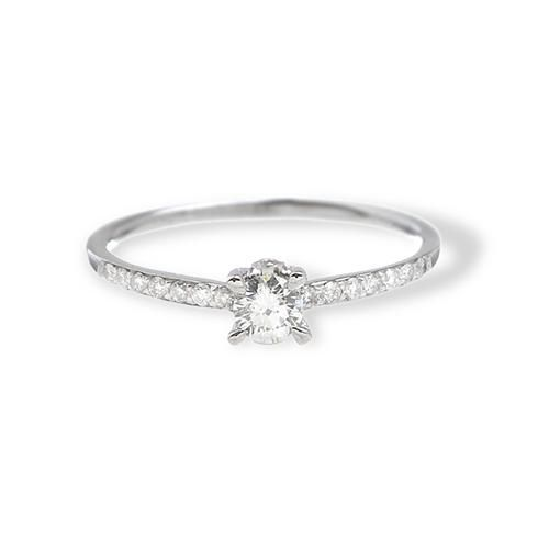 This stunning diamond engagement ring features a round brilliant center diamond with a micropave band and a bezel-set diamond in the crown.  at Greenwich Jewelers  $2825