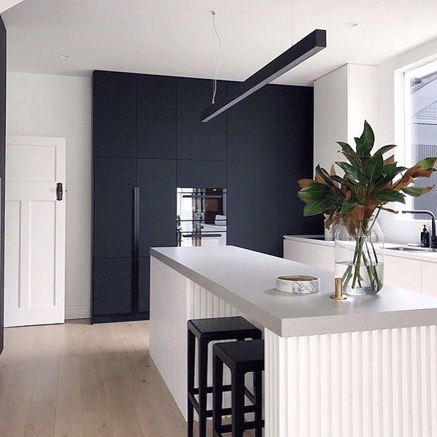 The Island Bench, Sleek Black Cabinetry And Pendant Light