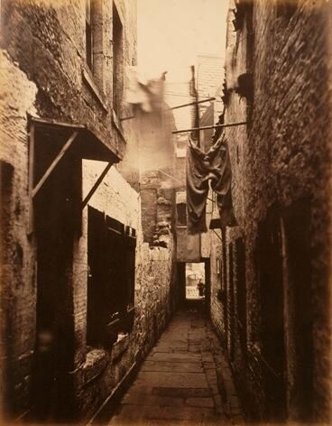 The infamous Seven Dials 1880s. You wouldn't walk down here in your Top Hat with a few bob in your pocket... :-)