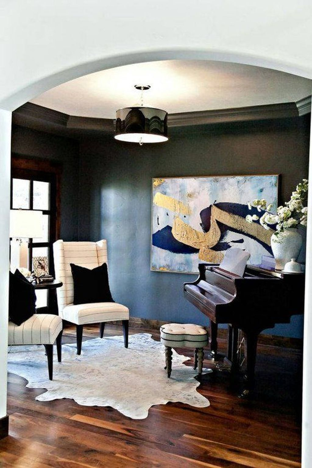 how to place a cowhide rug in living room
