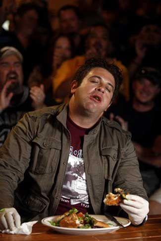 adam richman of man vs food tackles the four horsemen burger at chunky s burgers san antonio texas