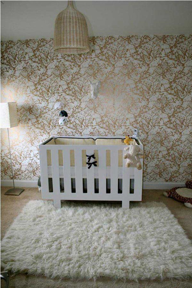 modern bedroom with brown baby room rugs using small white cot and