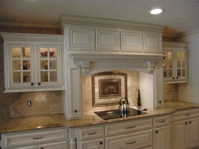 decorative range hood cover with crown molding and a decorative backsplash mural