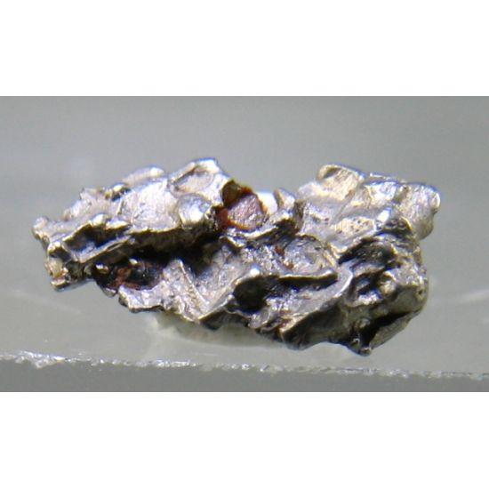 Platarsite, PtAsS, in native Platinum, Fox Gulch, Alaska, USA. 0.3 × 0.5 × 0.2…