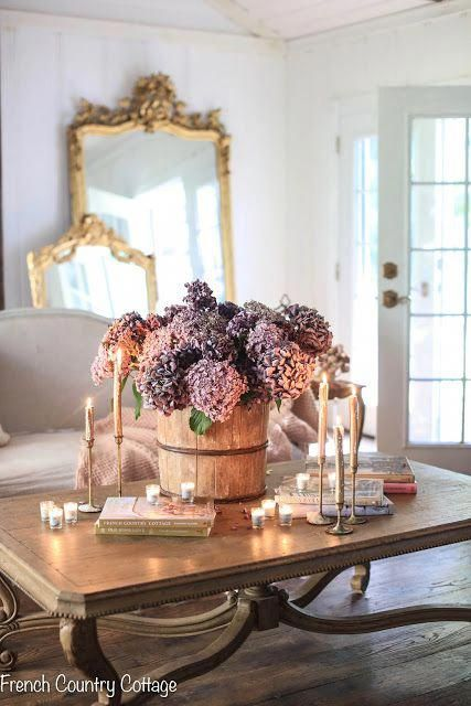 My fall home is filled with romantic purple, blush and gold home accessories! On the blog, I'm sharing how I decorated my living room with beautiful French accents, twinkling vintage candles, and classic pumpkins around the fireplace. #frenchcountrycottage #falldecorating #falldecor #holidaydecor #frenchvintage #frenchcountry #countrystyle #shabbychic #fireplacedecor #fallvignette #BeachBathroomDecor