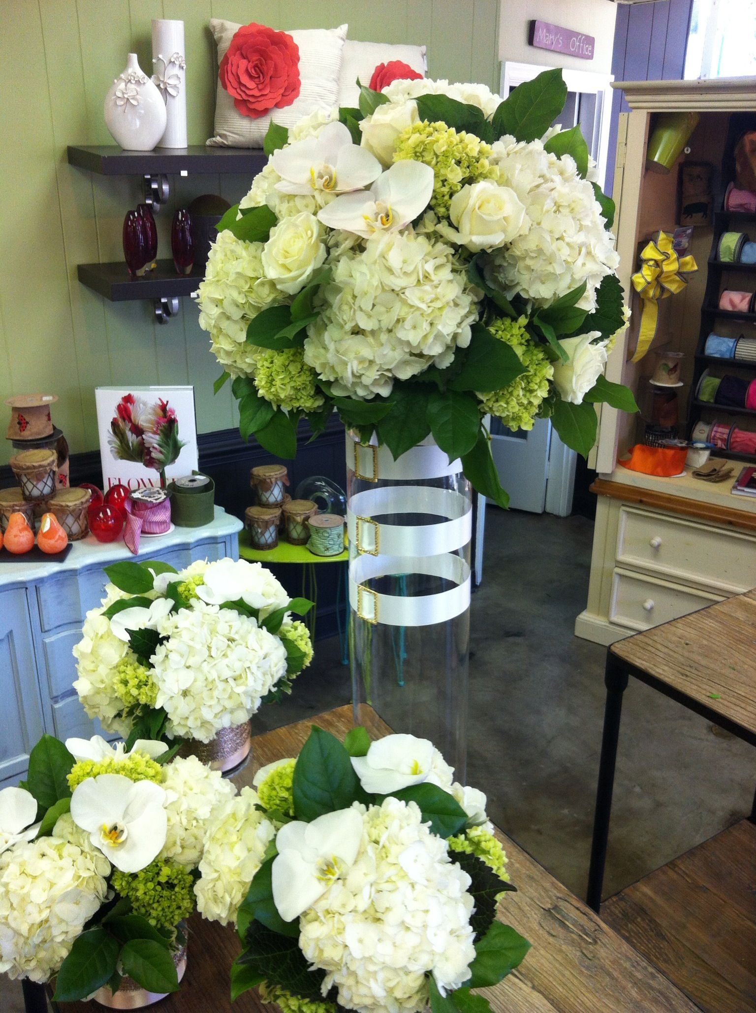 Stunning white floral arrangements with white orchids for