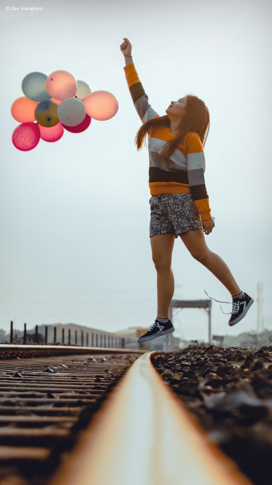 Happy Girl Jumping Balloons Train Track Photography