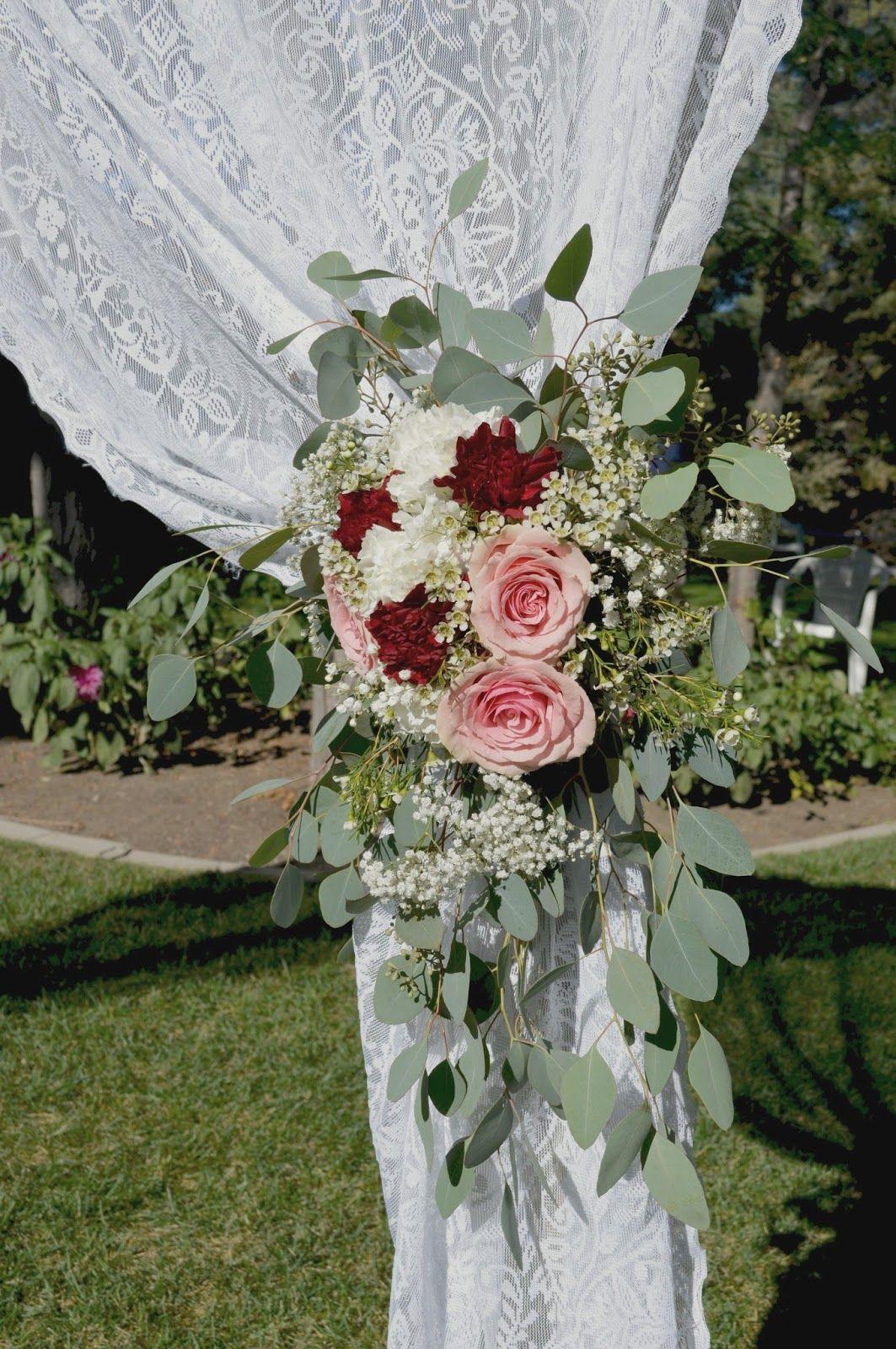 burgundy carnation, baby's breath and eucalyptus