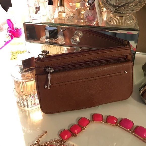 Brown wallet Never used! Brand new, Perfect condition! Unique wallet, Has 2 large pockets and a card/ money holder fold out compartment. Relic Bags Wallets