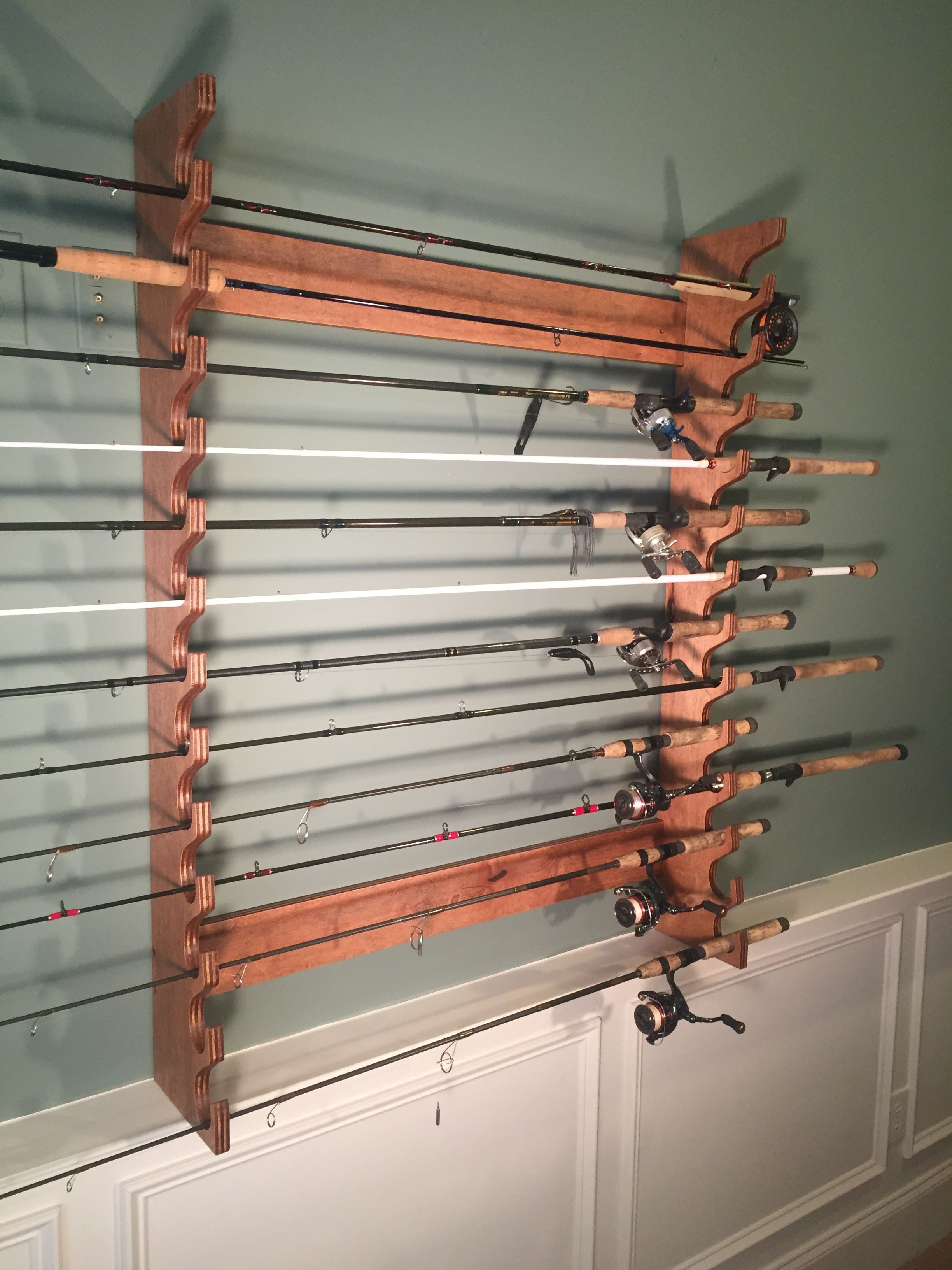 Wall mounted rod rack built by rods rest http for Fishing rod rack