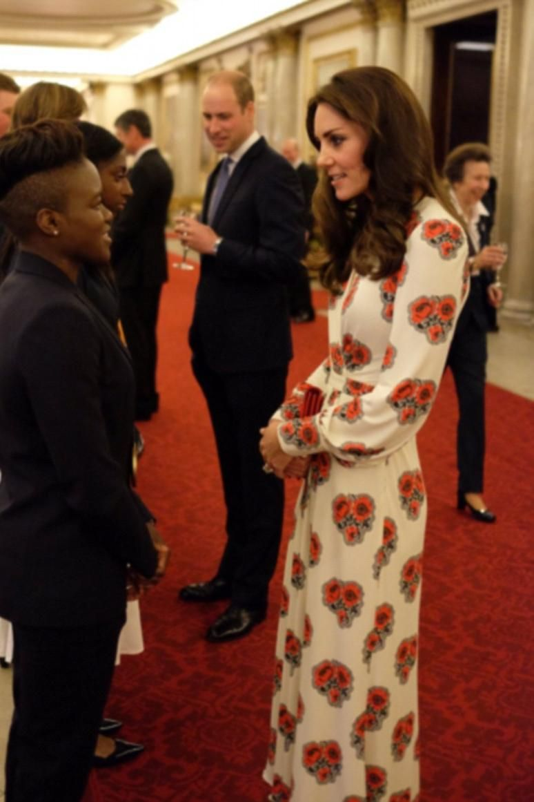 Kate Middleton wearing Garrards Jewellers Royal Engagement Ring, Gianvito Rossi Suede Pumps, Soru Jewellery Baroque Pearl Double Sided Earrings, Miu Miu Red Suede Bow Shoulder Bag and Alexander McQueen Slik Open-Back Midi Dress