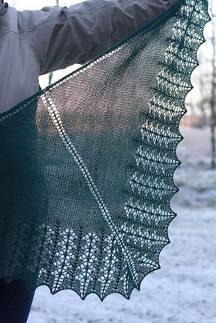 Frozen River is a classic triangle shawl in stockinette stitch and lace edging. DK weight yarn makes it quick to knit.