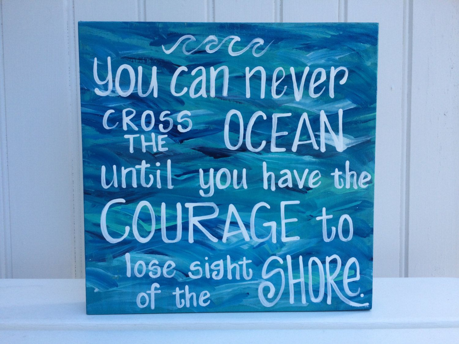 "Painted wood sign with beach waves and quote ""You can never cross the ocean until..."" Hand-painted made to order. Customization welcome. by PaintedSea on Etsy"