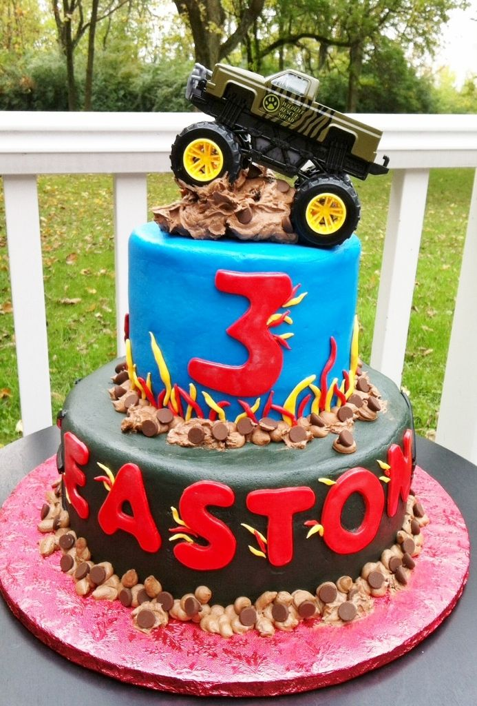 - Buttercream iced cakes with candy, fondant accents and toy truck.  Thanks for looking!  Lisa