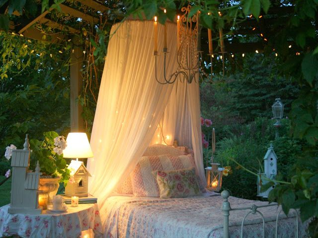 I love this so much.....I can't imagine anything better than sleeping outdoors, under fairy lights and a chandelier in this bed.  So perfect at sundown.  This woman's blog is full of gorgeousness.  Photos are her own and taken around her house/property!