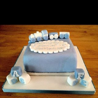 Baby boy cake - redecorated fruit cake from the top tier of a wedding cake