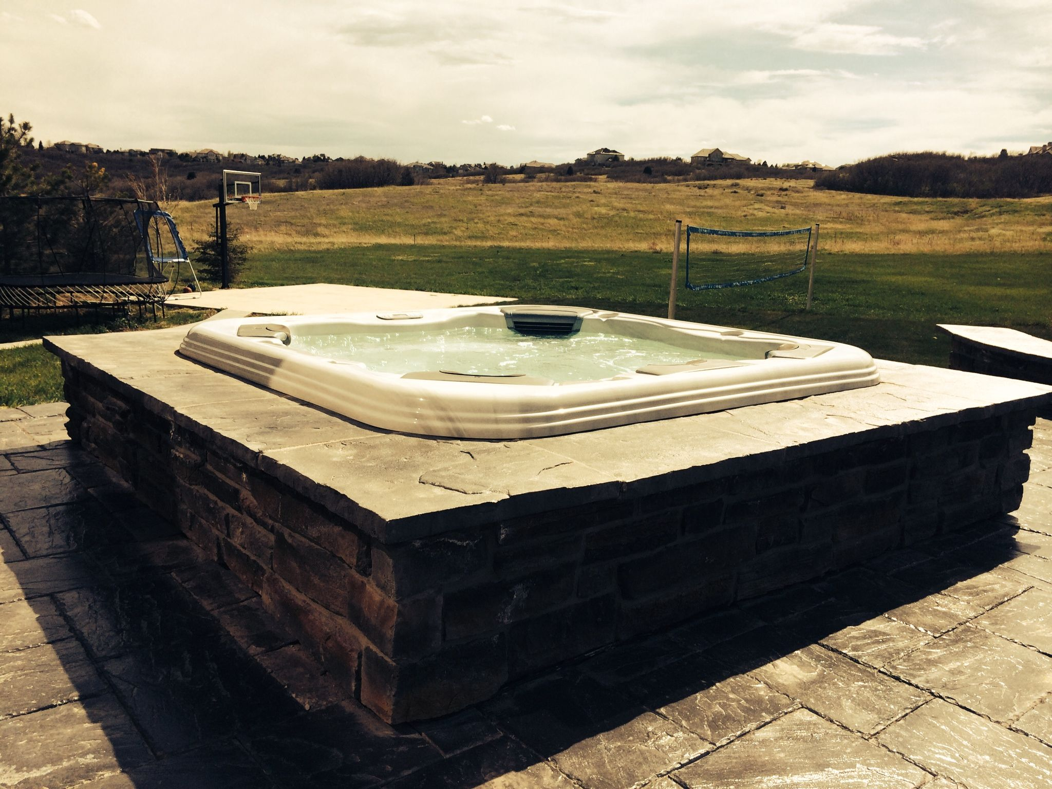 sparetailer image to a how spa explains best build larger in cradle bullfrog hot magazine tub tubs view