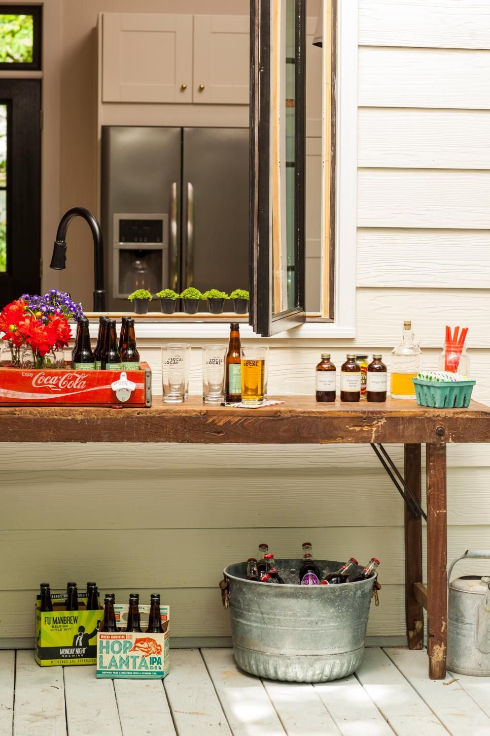 "Sam was originally going to build a bar that connected to the house, but then Lesley found this really great reclaimed folding table. ""We loved the idea that we could easily bring it out for parties and use it in the house the rest of the time,"" says Sam."