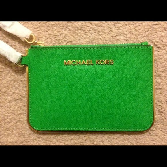 "SALE!! NWOT Michael Kors green wristlet SALE!!! Michael Kors green specchio wristlet.  Super cute!! Approx 6 1/2"" length & 4"" in height. Michael Kors Bags"