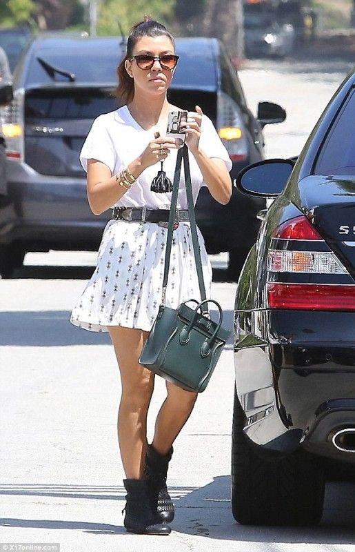 Kourtney Kardashian wearing Hermes Tassel Keychain in Black 2b9442d1246cc