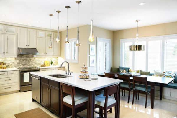 pendant lights above kitchen island hung at different heights to