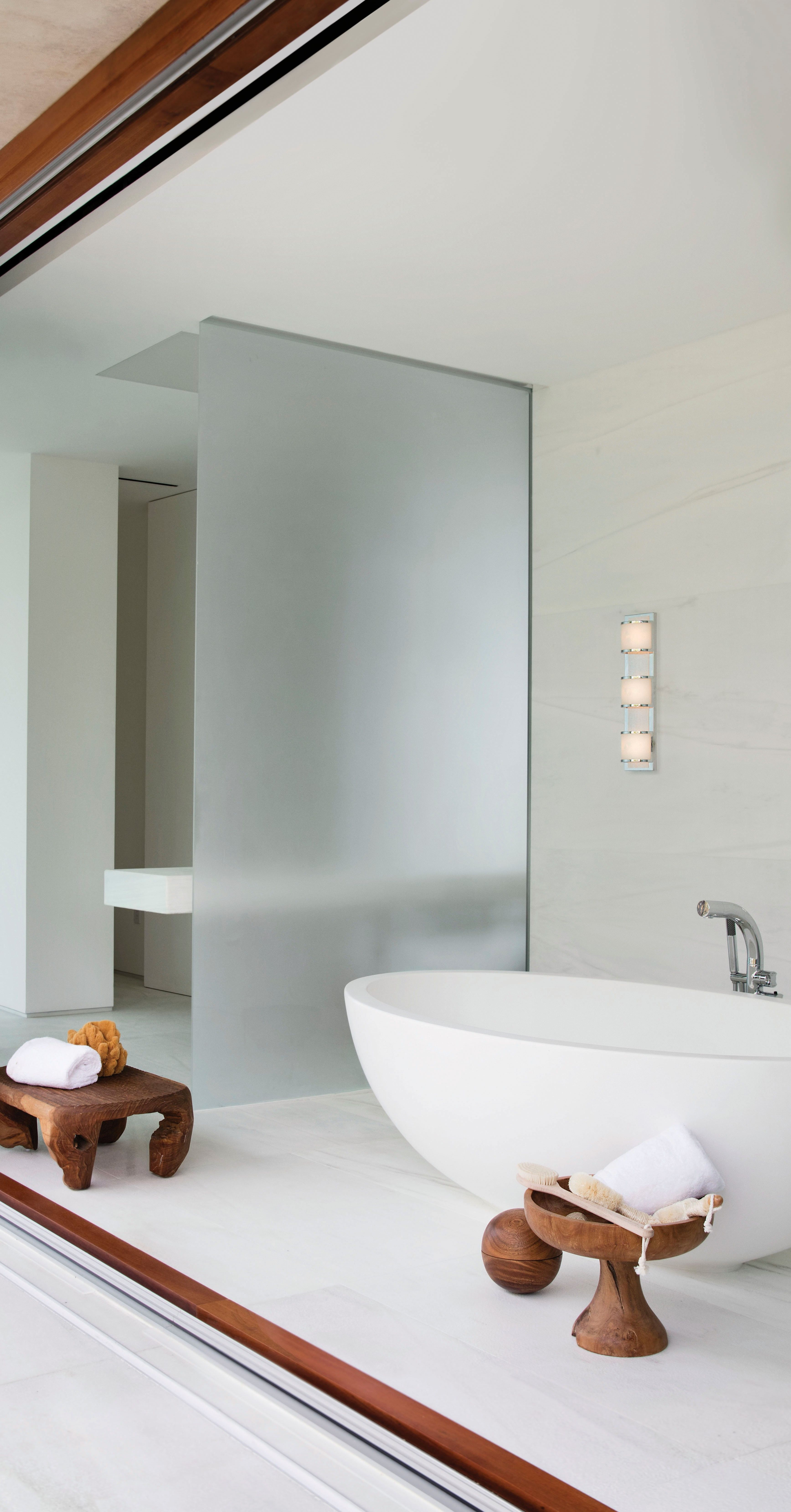 Modern White Bathroom With Frosted Glass And Bathtub Lit By Bathroom Wall Light Modern White Bathroom Bathroom Lighting Bathroom Wall Lights