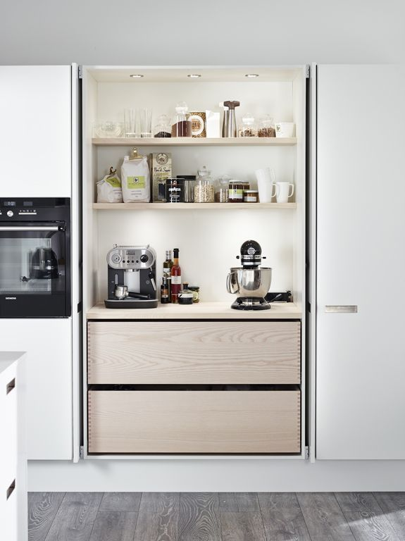 Great idea. Cupboard doors fold into cupboard exposing bench with big appliances hidden away, but easy to access and use.