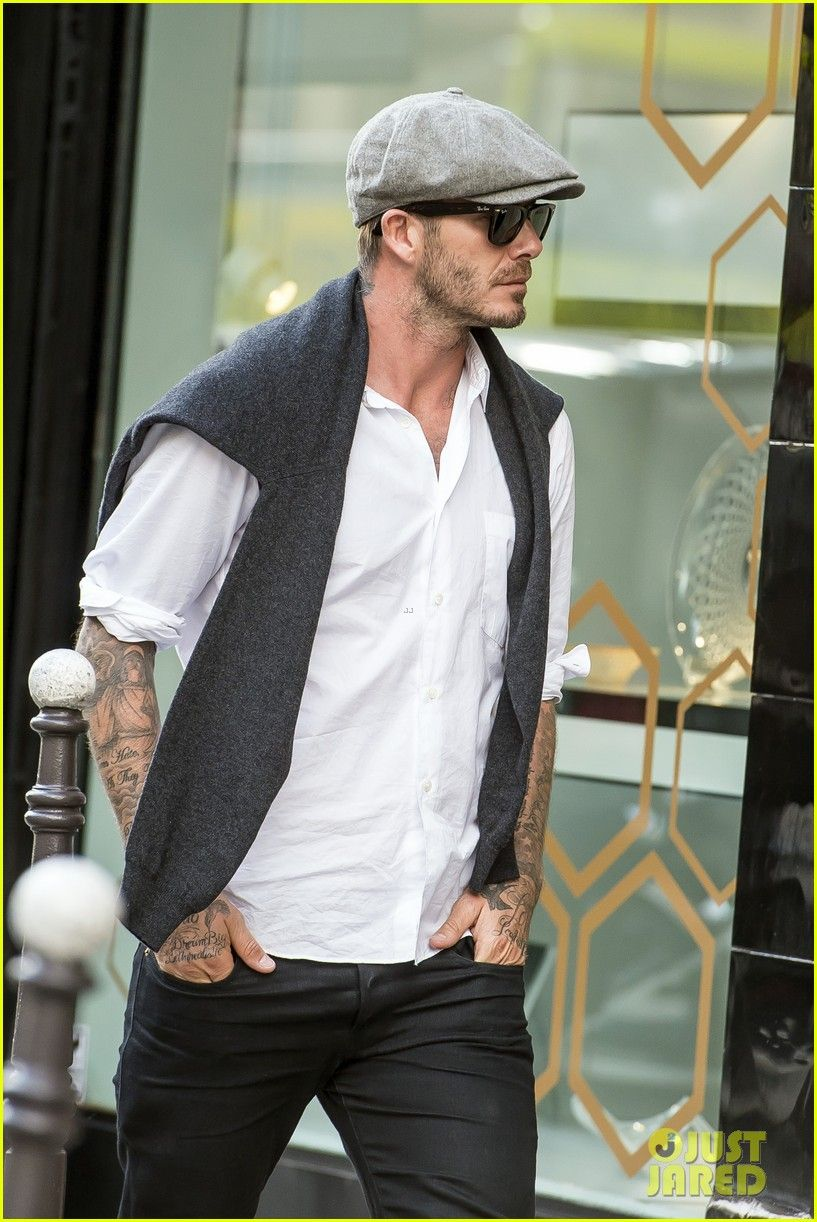 19997afba80b9 david beckham solo shopper saint laurent paris 01 David Beckham keeps a low  profile in a newsboy cap while picking up a few goodies during a shooping  spree ...
