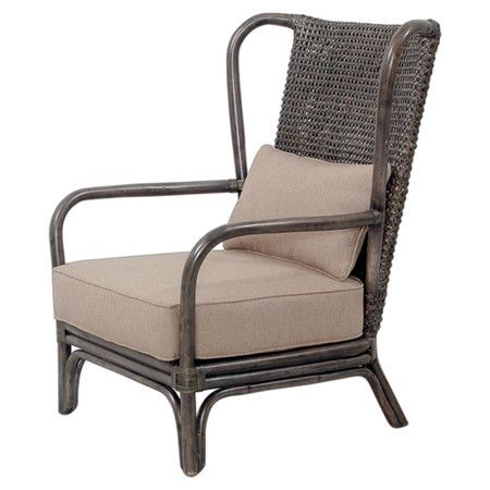 Handcrafted Of Teak And Rattan This Colonial Style Arm Chair Is