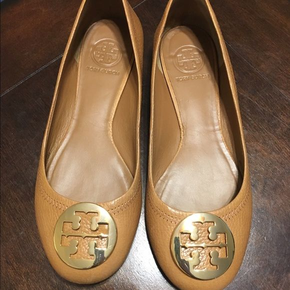 Tory burch flats I bought these Tory Burch flats from a fellow posher. They are too big for me so I am trying to resell them. I paid $135 and I just want to get my money back so I can buy a smaller pair. They look to be worn only a couple times. There is also a very tiny scratch on the right gold emblem. Comes with dust bag. Tory Burch Shoes Flats & Loafers