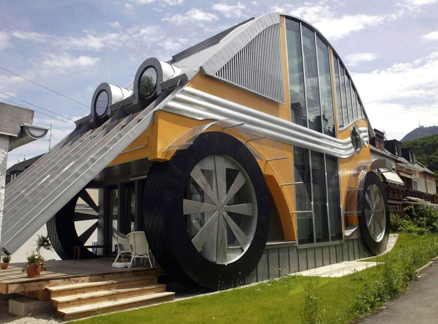 A car-shaped dwelling, built for a family of four, by architect Manfred Voglreiter, in the town of Langwied, in the Austrian Salzburg province, on June 23, 2004