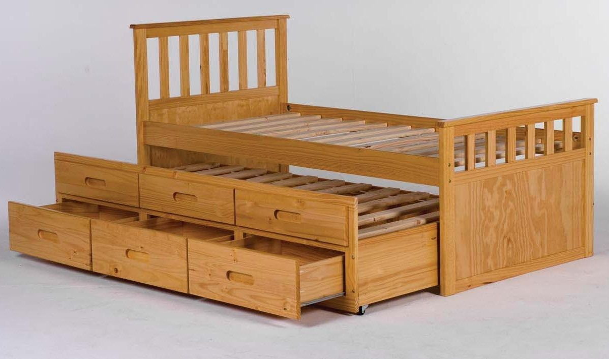 Small single bed with drawers underneath designing in