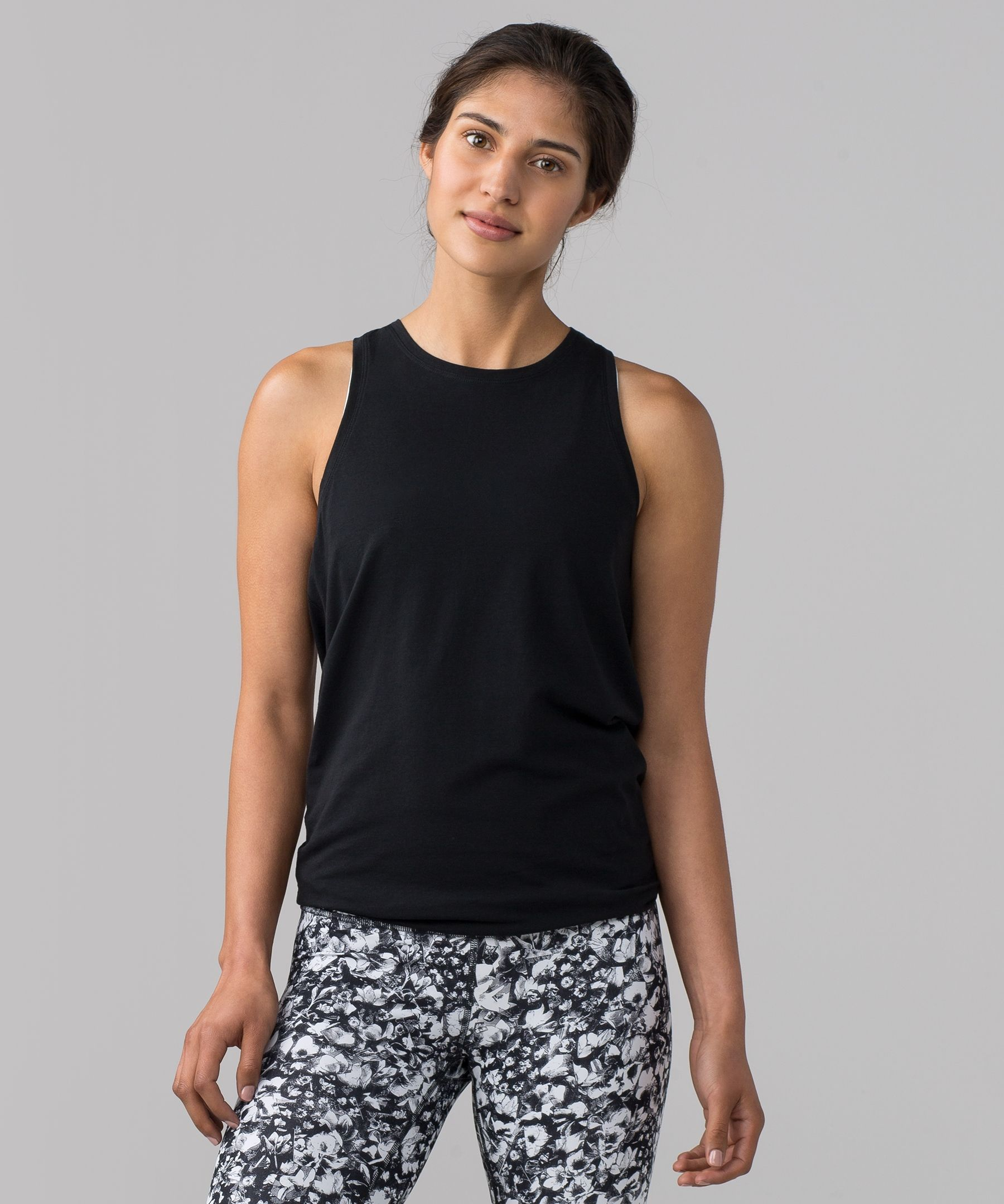 02dddbe9be Wear this tank two ways: layer it on long and loose or tie up the back to  secure in place during yoga class.