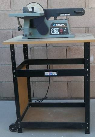 Used  Delta Belt Sander with Stand  Extra discs included