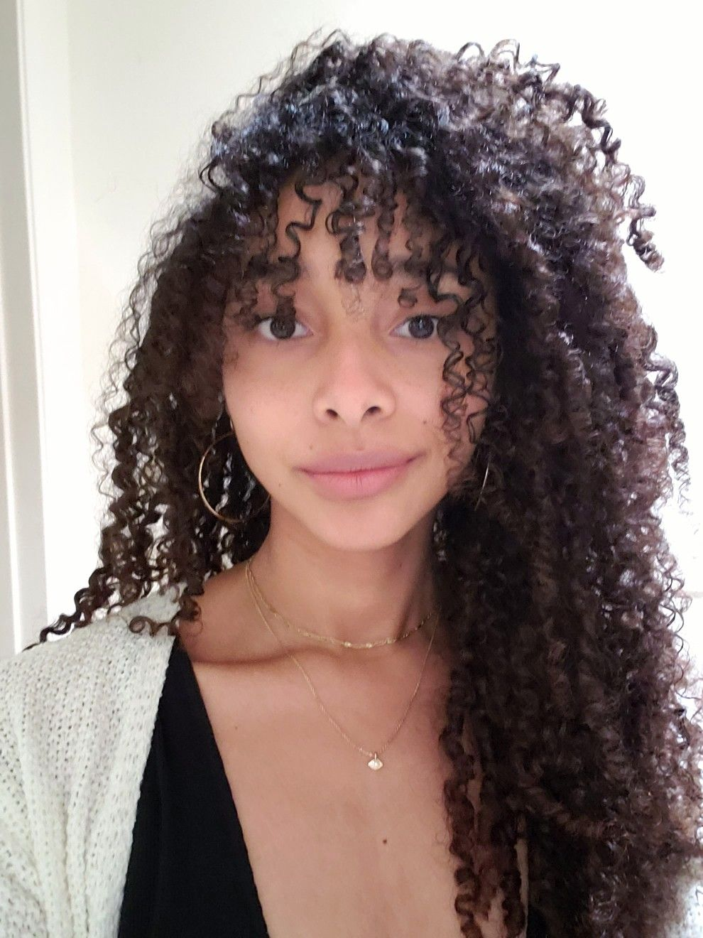 14+ Curly hair styles with bangs ideas in 2021