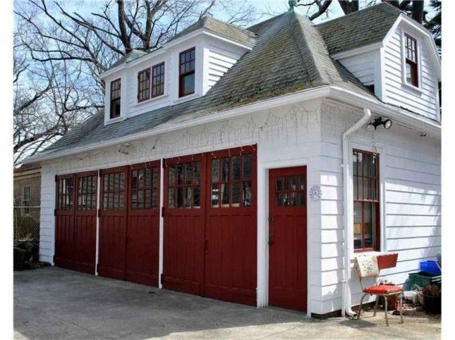 hip roof dormered three car carriage house