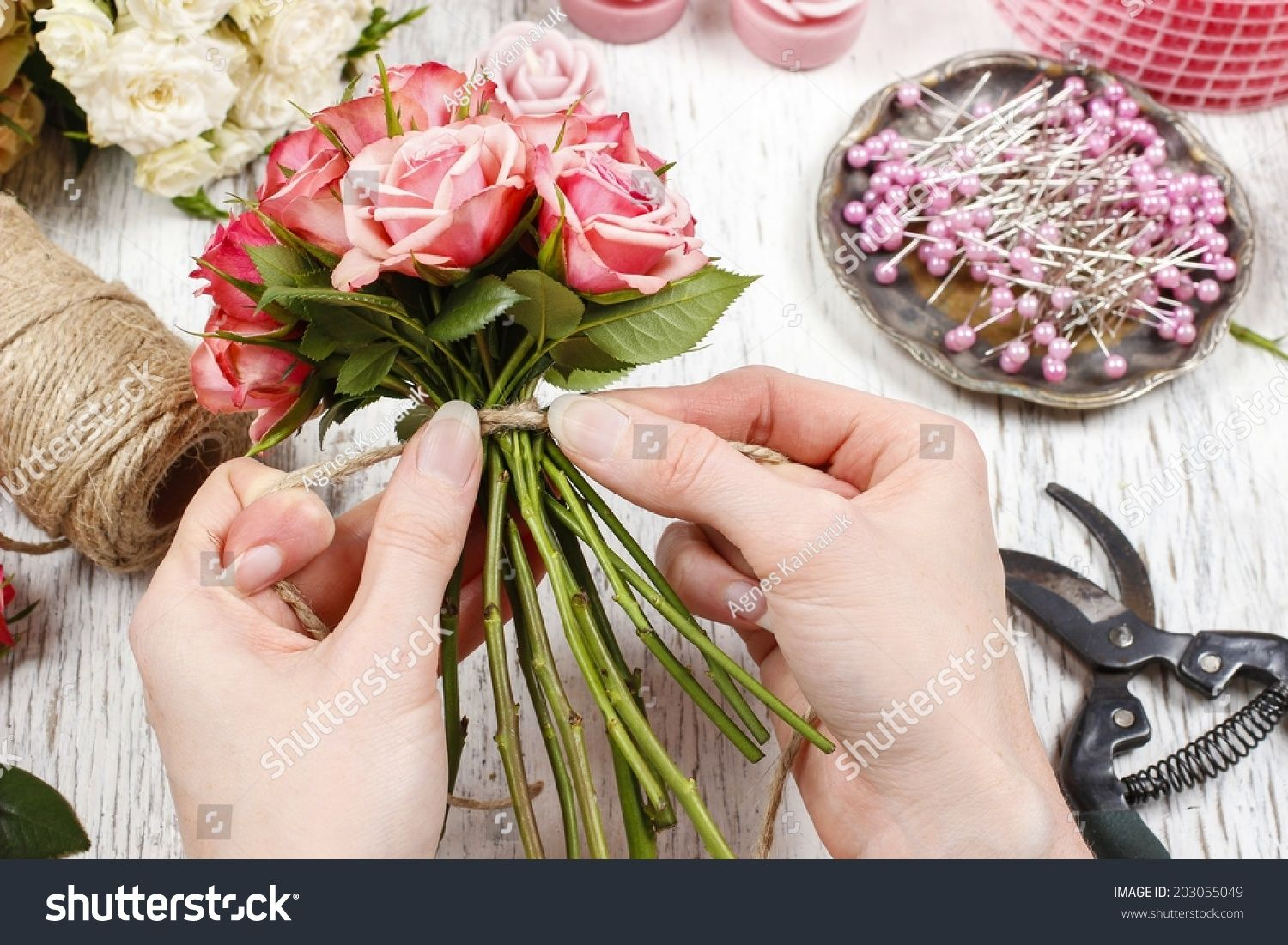 Florist At Work Woman Making Bouquet Of Pink Roses Flower Shop
