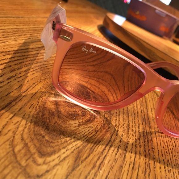Ray Ban Wayfarer 2140 New, never worn, pink/salmon wayfarers!! Has box, but is slightly torn up. No tag Ray-Ban Accessories Sunglasses