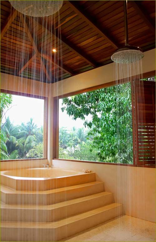 Good Unusual Showers #10: Large Master Bathroom With Twin Rainfall Showers And Unusual Soaking Tub  Overlooking The Jungle Gardens.