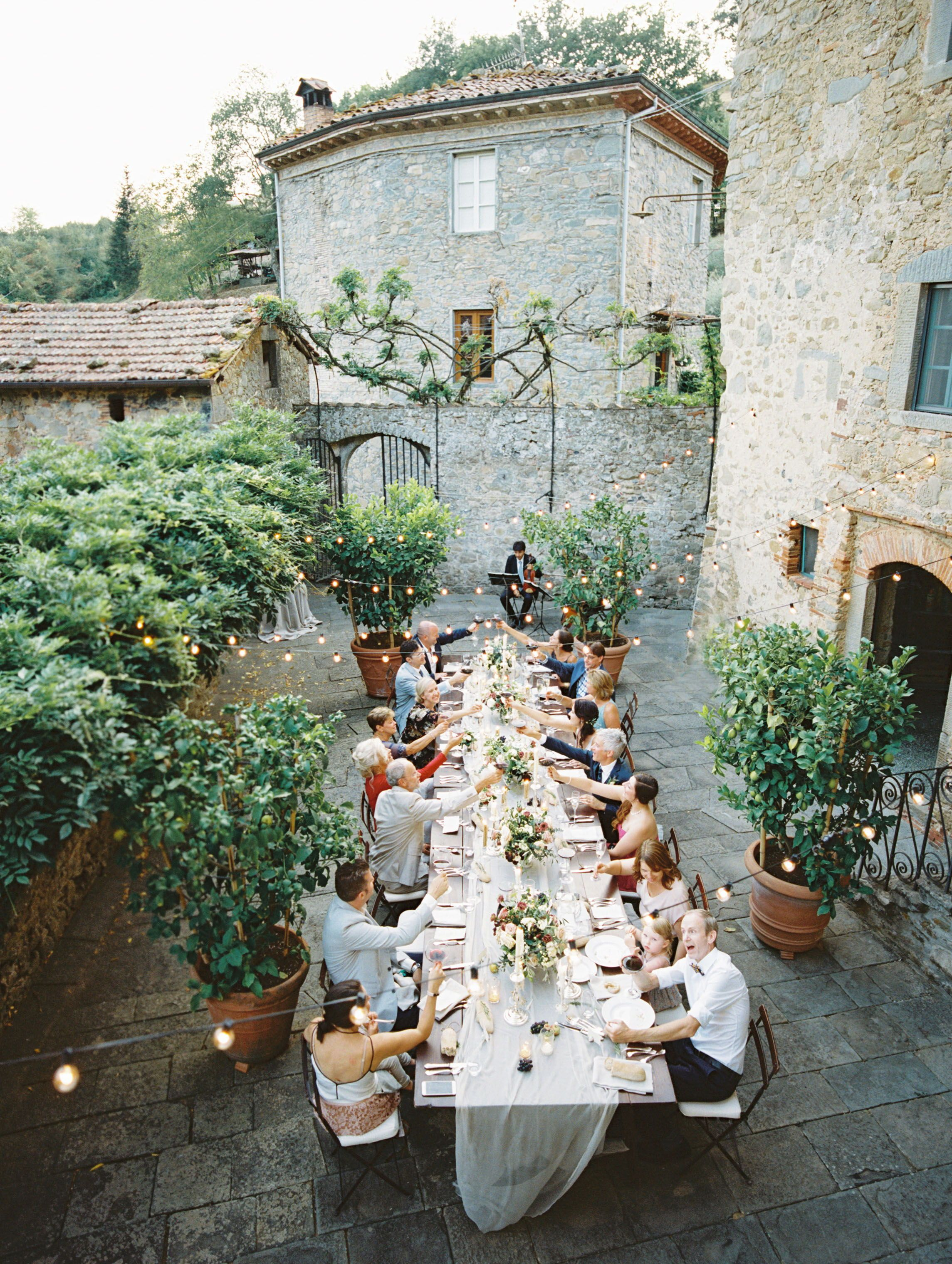Italian Intimate Destination Wedding In Tuscany Reception Dinner Guests Courtyard Tuscan Italy Blue Vil Tuscany Wedding Tuscan Wedding Italian Wedding