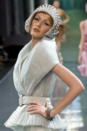A model presents a creation as part of British designer John Galliano's Haute Couture Autumn-Winter 2008-2009 fashion show for French fashion house Dior in Paris, June 30, 2008.