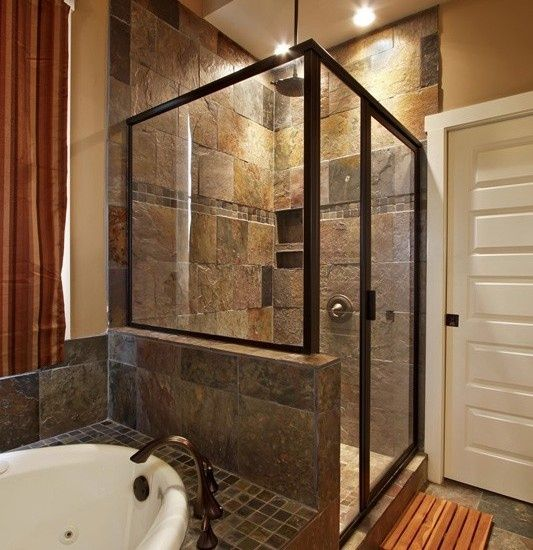 Dark and earthy stone feel, different tiles on top and side of surround.  Spa Bathrooms, Small Bathroom Showers ...