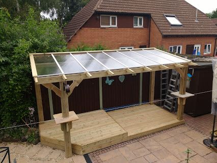 Bespoke Heavy Duty Wooden Pergola with clear roofing panels and stone  shelves. - Bespoke Heavy Duty Wooden Pergola With Clear Roofing Panels And