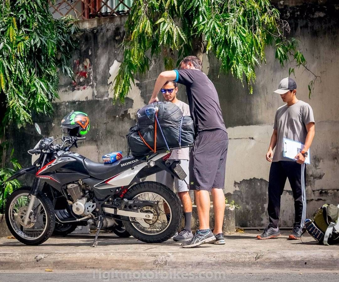 Tigit Boss Is Showing Customer To Put Luggage On The Bike